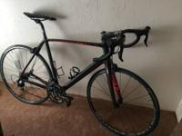 58 cm carbon frame. Original owner. Raced on it for a