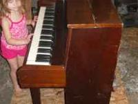 Diapason 64 key upright Wooded Piano. This piano is
