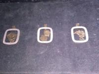 pewter pendants with horseracing, cards or dice on them