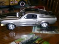 i have 4 die cast vintage cars for sale. first is a