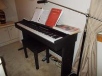 DIGITAL ELECTRIC PIANO BY ADIAGO WITH BENCH. ALSO