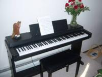 Yamaha Clavinova CLP-350. Never needs tuning. We are