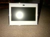 Digital photo frame. Never been used. Includes: Digital