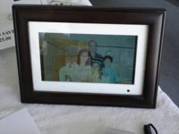 10 INCH DIGITAL PICTURE FRAME. HAS 2 REMOTES AND TAKES
