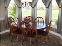 Solid wood table w/2leaves and 6 chairs  Location: Avon