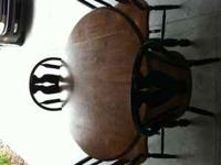 Round 52 inch kitchen table with 4 chairs bought from
