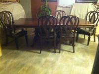 I Have For Sale 7 PC Dinette Set. It has Two End Arm