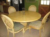 solid wood pedestal table is a birch color. The table