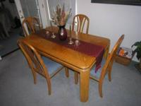 Dining Room Table with 4 chairs, coffee table, and side