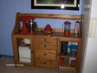 Wooden Dining Hutch. Has 4 drawers in the middle, and