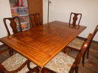 Large Table w/six chairs. Seats up to twelve with two