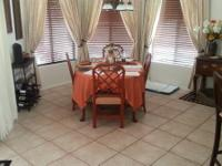 Kitchen Table with 4 matching chairs. There are 2 more