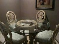 Beautiful Glass Top Dining Room Table with ornate