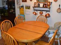 "A beautiful ""honey oak"" colored round dining space"