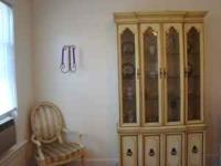 beautiful cream colored lighted hutch and buffet-french