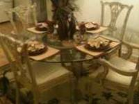 A dining room set for sale which includes a 54'' table