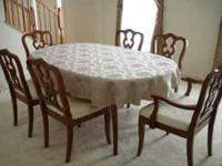 Complete dining room set. One arm chair, five regular