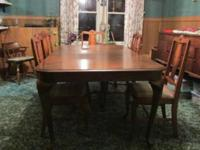 Table, six chairs, buffet and china cabinet. Chairs are