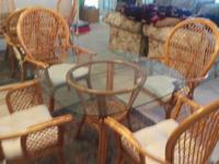 Beautiful 5 piece wicker/glass dining room set. Table+4