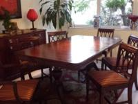 Table for six with six chairs and a cabinet. The whole
