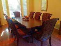 Beautiful wood table with 8 fabric chairs. 3.5 feet