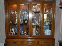 very nice dining room set , has lighted China closet,