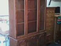 Very nice lighted china cabinet and table with 4 chairs