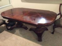 Real wood dining room table with 2 leaves and 6 chairs.