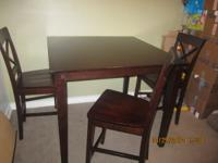 Bar height dining table with four chairs. Didn't clean