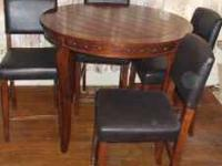 Bar height dining table and 4 chairs, minor scratches,