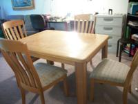 Solid wood dining room table with four upholstered