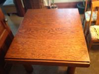 Dining space table that has a minimum size of 49x43 and
