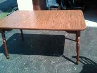 Dining room table is 4 ft without leaf extension and 5