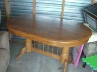 Oval shaped wooden dining room table, asking $50 if