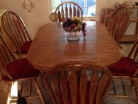 60-84x42x30 oak dining room table 6 chairs with pads