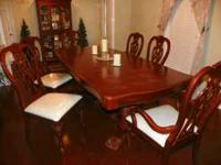 We have for sale a beautiful solid wood table and 4
