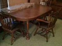 Solid wood dining room table with 3 chairs. 3 leaves