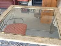 Selling a glass top dining room table and four chairs
