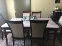 Beautiful dining room table with six chairs for sale.