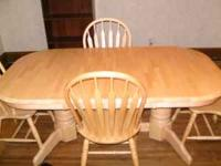 Beautiful solid light wood dining room table and 4