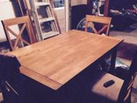 Dining room table and 4 chairs. Table i excellent