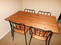 Dining table with 4 chairs. Great set that hasn't been