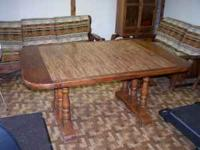 Up for sale are a dining room table and four chairs.