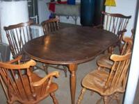 Nice antique dining table and 6 chairs. Will not