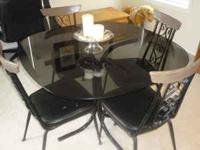 glass table top dining room table with 4 chairs. The