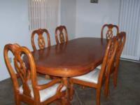 Have a dining room table with 6 chairs for sale. Asking
