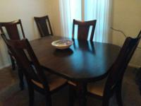 Beautiful dining room table and 6 chairs with pads