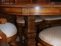 Beautiful dining room set with nice carved details.