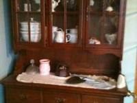 Dining room table, 6 chairs, and china hutch asking 200