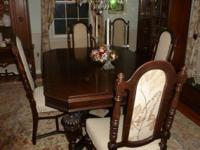 Beautifully designed cherry stained maple dining room